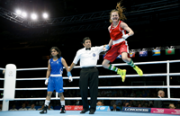 Northern Ireland's Michaela Walsh (R) reacts to winning the bout against India's Pinki Rani (L) during the Womenís Fly (48-51 kg) semi-final boxing match at the 2014 Commonwealth Games in Glasgow, Scotland, on August 1, 2014. AFP PHOTO / ADRIAN DENNIS