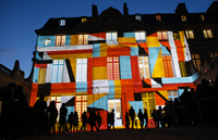 Video mapping is used to display a projection on the Hotel Sale which houses the Picasso Museum in Paris, as part of the 11th edition of the European museum night, on May 16, 2015. The European museum night was created in 2005 by the French Ministry of Culture and Communication, with the closing time of the museums postponed to approximately one in the morning, allowing the public to visit the participating museums by night, for free. AFP PHOTO / THOMAS SAMSON