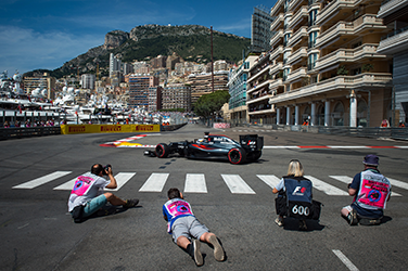 McLaren Honda's Spanish driver Fernando Alonso drives as photographgers take pictures during the third practice session at the Monaco street circuit, on May 28, 2016 in Monaco, one day ahead of the Monaco Formula 1 Grand Prix. AFP PHOTO / ANDREJ ISAKOVIC